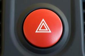 a large red hazard warning light button